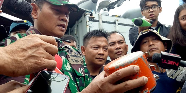 Indonesian Navy Commander Rear Admiral Yudo Margin shows the recovered cockpit voice recorder of Lion Air flight 610 that crashed into the sea in October during a press conference on board of the navy ship KRI Spica in the waters off Tanjung Karawang, Indonesia, Monday, Jan. 14, 2019. Navy divers have recovered the cockpit voice recorder in a possible boost to the accident investigation. (AP Photo/Achmad Ibrahim)