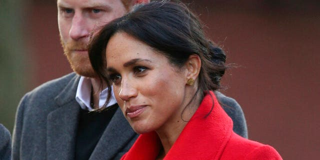 Meghan, the Duchess of Sussex and Britain's Prince Harry discuss about with a brand unique sculpture in Hamilton Square to designate the one centesimal anniversary of battle poet Wilfred Owen's death, at some level of a discuss about with to Birkenhead, England.