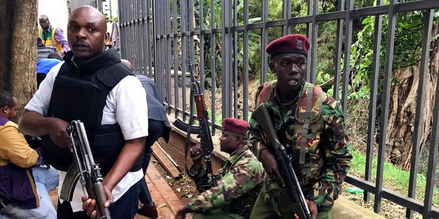 Security forces are seen at the scene of a blast in Nairobi.