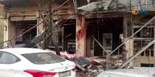 This frame grab from video provided by Hawar News, ANHA, the news agency for the semi-autonomous Kurdish areas in Syria, shows a damaged restaurant where an explosion occurred, in Manbij, Syria, Wednesday. The Britain-based Syrian Observatory for Human Rights, a Syrian war monitoring group, and a local town council said Wednesday that the explosion took place near a patrol of the U.S.-led coalition and that there are casualties. (ANHA via AP)