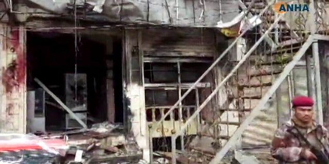 This frame grab from video provided by Hawar News, ANHA, the news agency for the semi-autonomous Kurdish areas in Syria, shows a damaged restaurant where an explosion occurred, in Manbij, Syria, Wednesday.