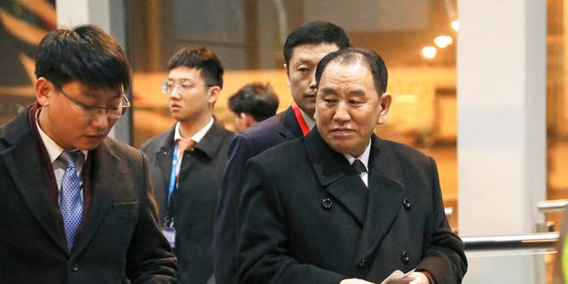 North Korean official Kim Yong Chol, right, preparing to leave the Beijing International Airport on Thursday. (Kyodo News via AP)