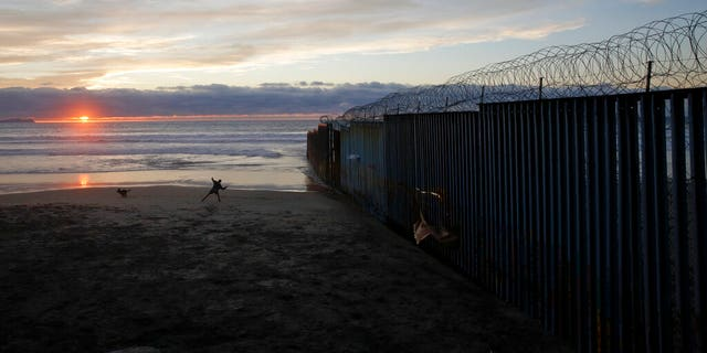 The border wall topped with razor wire in Tijuana, Mexico, earlier this month. (AP Photo/Gregory Bull, File)