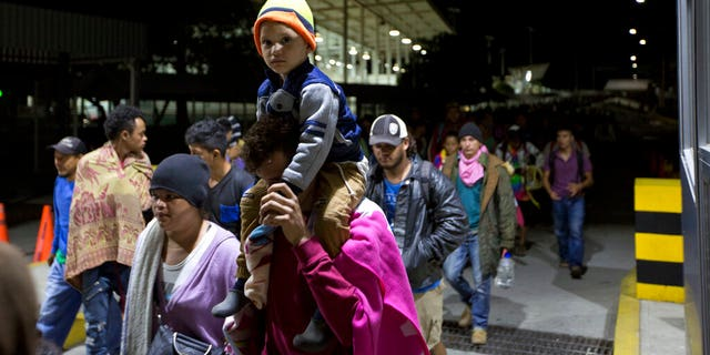 New Caravan Migrants Break Border Gate into Mexico