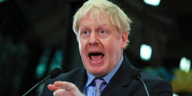 British lawmaker Boris Johnson speaks at the headquarters of construction equipment company JCB in Rocester, England, Friday Jan. 18, 2019. The former Foreign Secretary Johnson made his speech as a leading advocate of Britain's Brexit split from Europe. (Peter Byrne/PA via AP)