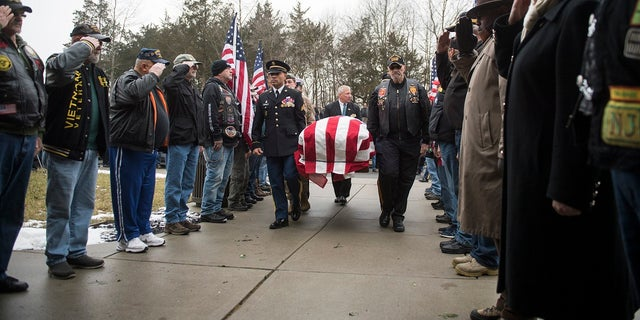 Pallbearers carry the casket of Vietnam veteran Peter Turnpu as several hundred gather for a funeral Friday, Jan. 18, 2019 in Wrightstown, N.J. (Associated Press)
