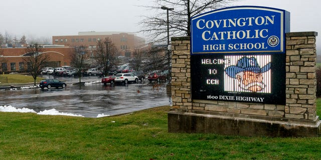 A diocese in Kentucky apologized Saturday after videos emerged showing Covington Catholic High School students in the confrontation. (AP Photo/Bryan Woolston)