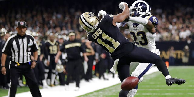 New Orleans Saints wide receiver Tommylee Lewis (11) works for a catch against Los Angeles Rams defensive back Nickell Robey-Coleman (23) during the second half of the NFC Championship Game, in New Orleans, Jan. 20, 2019. (Associated Press)