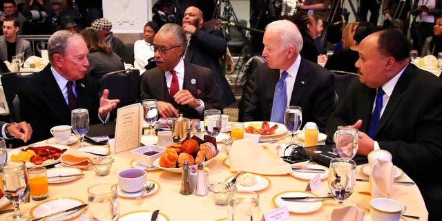 From left, former New York City Mayor Michael Bloomberg, Rev. Al Sharpton, former Vice President Joe Biden and Martin Luther King Jr III, during a commemoration of Martin Luther King Day in Washington on Monday. (AP Photo/Manuel Balce Ceneta)