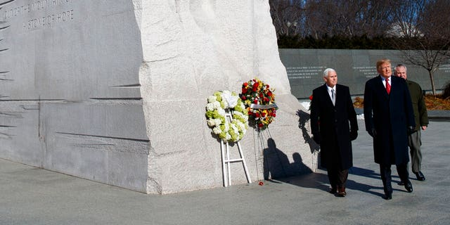 President Trump and Vice President Pence, left, escorted by Acting Interior Secretary David Bernhardt, visited the Martin Luther King Jr. Memorial on Monday in Washington. (AP Photo/ Evan Vucci)