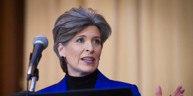 Sen. Joni Ernst, R-Iowa, speaks during the signing of an order withdrawing federal protections for countless waterways and wetlands, at EPA headquarters in Washington. (AP Photo/Cliff Owen, File)
