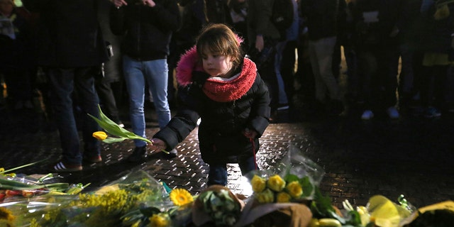 Residents of Nantes, western France, and FC Nantes soccer fans are gathered in the city center to pay tribute to FC Nantes soccer player Emiliano Sala of Argentina, Tuesday, Jan. 22, 2019. The French civil aviation authority said Tuesday, Emiliano Sala was aboard a small passenger plane that went missing off the coast of the island of Guernsey. (AP Photo/David Vincent)