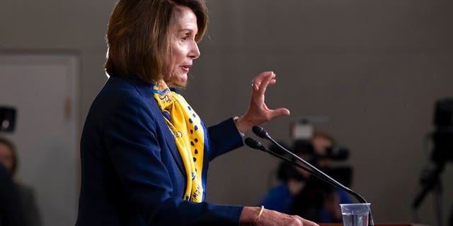 Speaker of the House Nancy Pelosi, D-Calif., talks to reporters a day after officially postponing President Donald Trump's State of the Union address until the government is fully reopened, at the Capitol on Thursday. (AP Photo/J. Scott Applewhite)