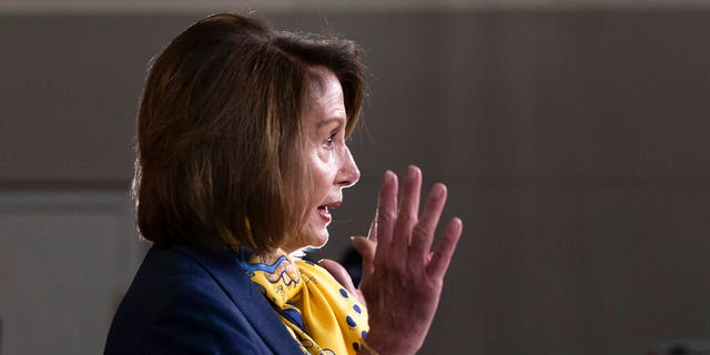 Speaker of the House Nancy Pelosi, D-Calif., talks to reporters a day after officially postponing President Donald Trump's State of the Union address until the government is fully reopened, at the Capitol in Washington, Thursday, Jan. 24, 2019. (AP Photo/J. Scott Applewhite)