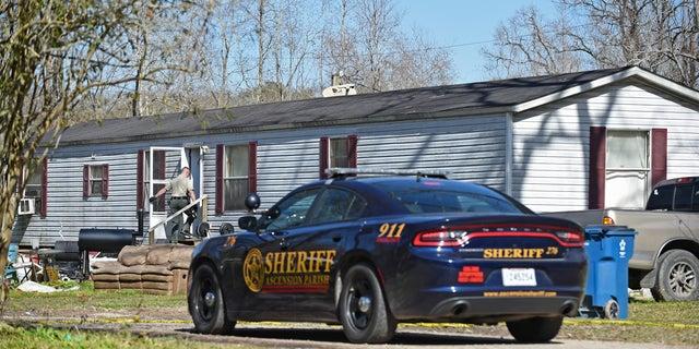 Investigators work the scene of a shooting on Saturday in Ascension Parish in Louisiana.
