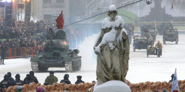 A Soviet World War II T-34 tank drives during a military parade at Dvortsovaya (Palace) Square during the celebration of the 75th anniversary of the end of the Siege of Leningrad during World War II in St.Petersburg, Russia, Sunday, Jan. 27, 2019.
