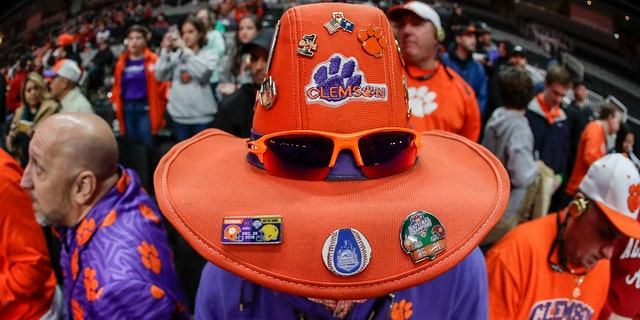 A Clemson fan watches media day for the NCAA college football playoff championship game Saturday, Jan. 5, 2019, in Santa Clara, Calif.