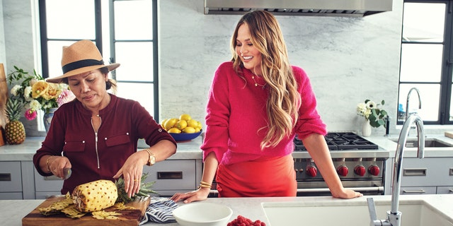 Chrissy Teigen, right, with her mother Vilailuck.