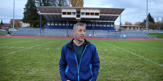 Former Bremerton High School assistant football coach Joe Kennedy stands at the center of the field on the 50 yard line at Bremerton Memorial Stadium, Nov. 5, 2015. (Larry Steagall/Kitsap Sun via AP)