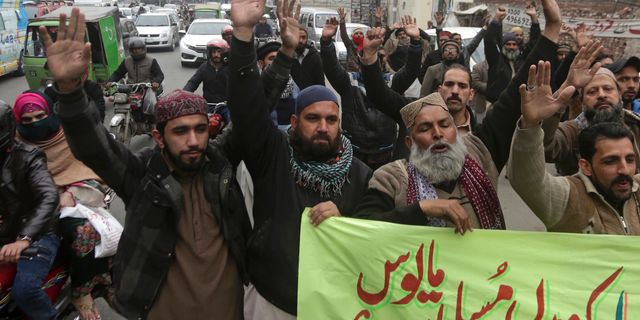 Activists from the Pakistani religious party Sunni Threek protest the Supreme Court's decision to uphold the acquittal of Aasia Bibi, in Lahore, Pakistan, Wednesday, Jan. 30, 2019. (AP Photo/K.M. Chaudhry)