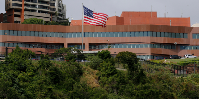 The U.S flag flies outside the U.S. embassy in Caracas, Venezuela, which remains open in the face of continuing local unrest.
