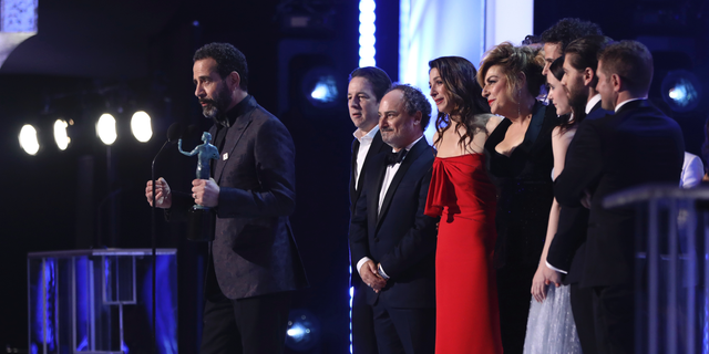 "Brian Tarantina, second from left, joins the cast of ""The Marvelous Mrs. Maisel"" in accepting the award for outstanding performance by an ensemble in a comedy series at the Screen Actors Guild Awards in January 2019. (Photo by Matt Sayles/Invision/AP)"