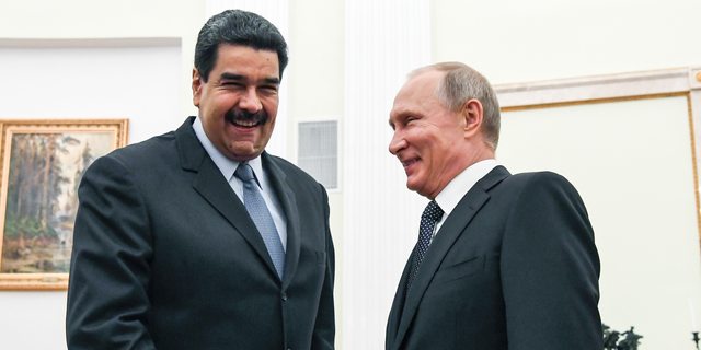 Vladimir Putin and Nicolas Maduro in 2017. (Yuri Kadobnov/Pool Photo via AP, File)