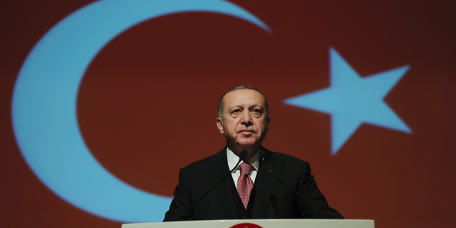 Turkey's President Recep Tayyip Erdogan delivers a speech during a military academy ceremony in Ankara, Turkey, Thursday Jan. 24, 2019. Erdogan says he is shocked by U.S. President Donald Trump's decision to recognise Venezuelan opposition leader Juan Guaido's claim to the presidency.(Presidential Press Service via AP, Pool)