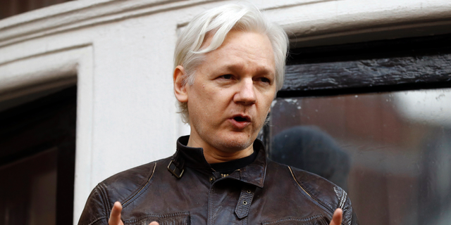 FILE - In this May 19, 2017 file photo, WikiLeaks founder Julian Assange gestures to supporters outside the Ecuadorian embassy in London, where he has been in self imposed exile since 2012. A federal judge has rejected a request to unseal criminal charges against Assange that were mistakenly revealed in another case. In a ruling issued Wednesday, Jan. 30, 2019, U.S. District Judge Leonie Brinkema said that free-press advocates seeking to unseal the charges have no proof Assange has actually been charged. (AP Photo/Frank Augstein, File)