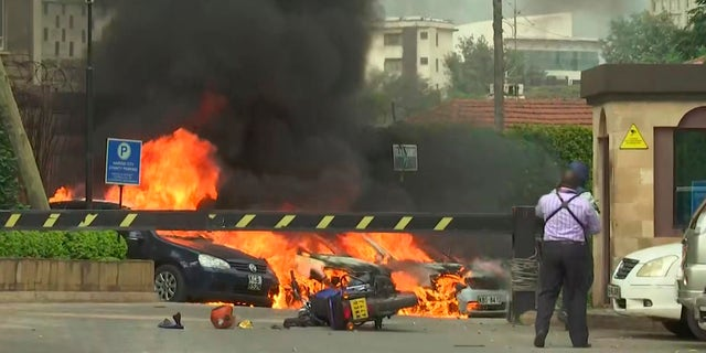 This frame taken from video shows a scene of an explosion in Kenya's capital, Nairobi, on Jan. 15. Gunfire and explosions were reported near an upscale hotel complex. (AP Photo/Josphat Kasire)