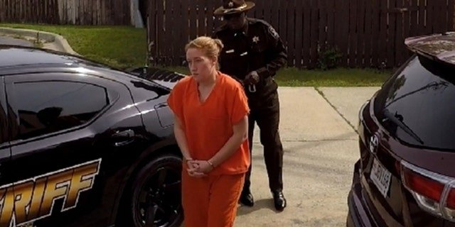 Fallon Blackwood walks into the Macon County, AL courthouse in October after authorities in North Carolina issued a warrant for obtaining property under false pretenses.