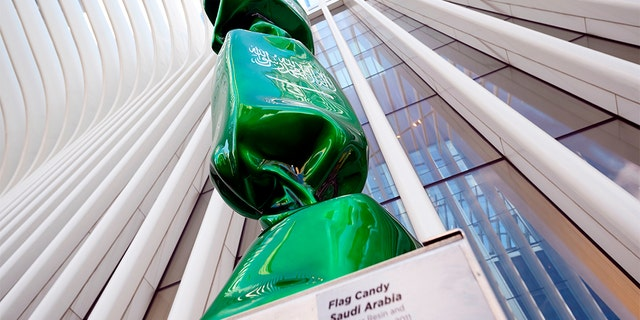 An art exhibitnear Ground Zero in New York that features a piece of candy draped in the Saudi Arabian flag will be removed from the site, officials said.