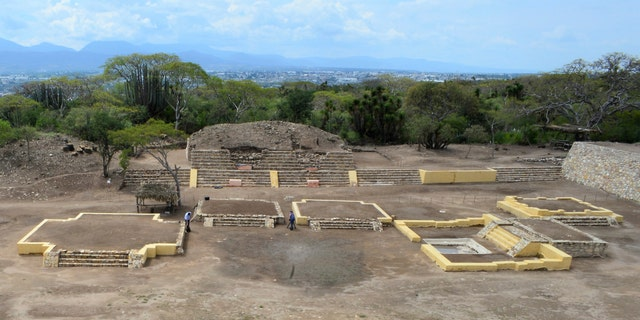 In this 2018 photo provided by Mexico's National Institute of Anthropology and History, INAH, investigators work at the Ndachjian - Tehuacan archaeological site in Tehuacan, Puebla state, Mexico, where archaeologist have identified the first known temple to the Flayed Lord, a pre-Hispanic fertility god depicted as a skinned human corpse. (Meliton Tapia Davila/INAH via AP)