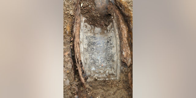 An image taken on Jan. 18, 2019 and issued by HS2 showing the lead plate placed on top of the coffin of Captain Matthew Flinders at the archaeological excavation and research works at the St James's Gardens burial ground in Euston, London.