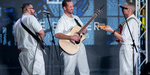Three inmates serve on the worship team during a service at Gateway Church's newest campus, Coffield Unit, which is also the largest prison in Texas.
