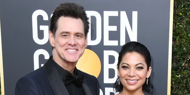 Jim Carrey and girlfriend Ginger Gonzaga attend Golden Globes together