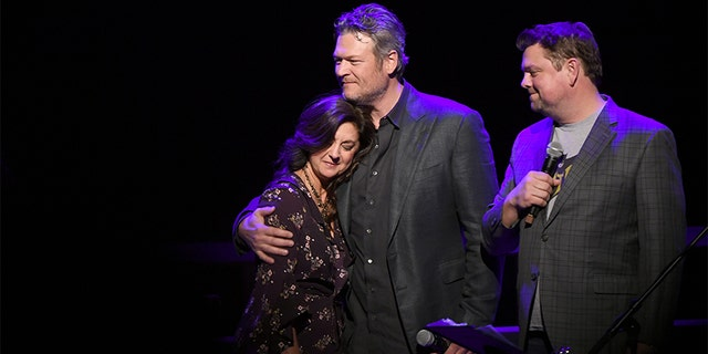 Angie Gentry, Blake Shelton and Storme Warren speak onstage during C'Ya on The Flipside benefit concert, benefitting The Troy Gentry Foundation at The Grand Ole Opry on January 9, 2019 in Nashville. — Getty