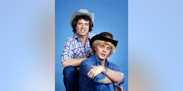 """American actors Tom Wopat (left) and John Schneider in a promotional portrait for the TV show """"The Dukes of Hazzard"""", circa 1980."""