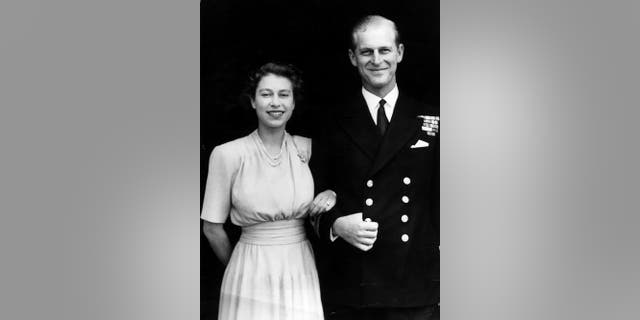 10th July 1947: The first official picture after the announcement of the engagement of Princess Elizabeth and Lieutenant Philip Mountbatten, the former Prince Philip of Greece, at Buckingham Palace. The princess is wearing her engagement ring for the first time. (Photo by Hulton Archive/Getty Images)