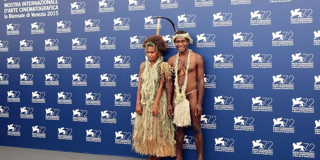 VENICE, ITALY - SEPTEMBER 08: (L-R) Marie Wawa and Mungau Dain attend a photocall for 'Tanna' during the 72nd Venice Film Festival at Palazzo del Casino on September 8, 2015 in Venice, Italy.