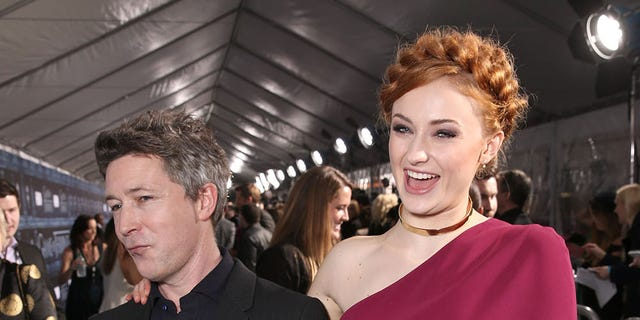Aidan Gillen and Sophie Turner attend the premiere of HBO's