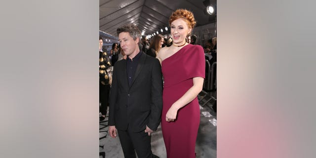 "Aidan Gillen and Sophie Turner attend the premiere of HBO's ""Game Of Thrones"" Season 6 at TCL Chinese Theatre on April 10, 2016 in Hollywood, California."