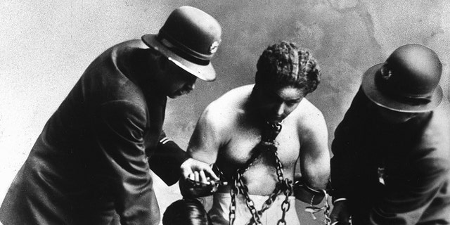 Harry Houdini in chains. — Getty