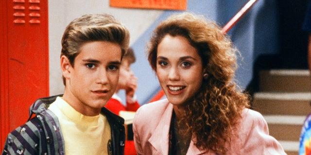 """SAVED BY THE BELL -- """"Screech's Woman"""" Episode 5 -- Pictured: (l-r) Mark-Paul Gosselaar as Zachary 'Zack' Morris, Elizabeth Berkley as Jessica 'Jessie' Myrtle Spano."""