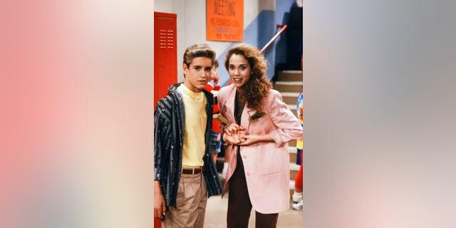 """SAVED BY THE BELL -- """"Screech's Woman"""" Episode 5 -- Mark-Paul Gosselaar as Zachary 'Zack' Morris and Elizabeth Berkley as Jessica 'Jessie' Myrtle Spano."""