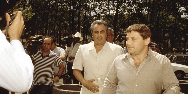 "John Gotti, center, enters the Brooklyn Federal courthouse with Sammy ""The Bull"" Gravano in May 1986, in New York City. — Getty"