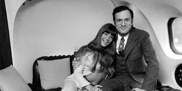 Playboy chief Hugh Hefner with model Barbi Benton, aboard his private Douglas DC9-30 plane, nicknamed The Big Bunny.