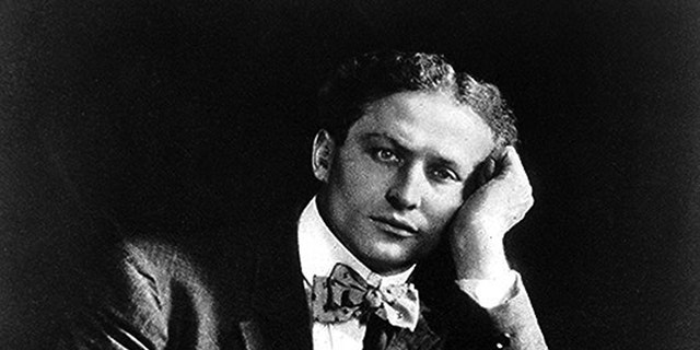 Magician Harry Houdini poses for a portrait in 1908.