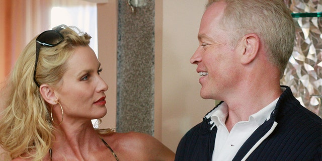 "Nicolette Sheridan and Neal McDonough in ""Desperate Housewives."""
