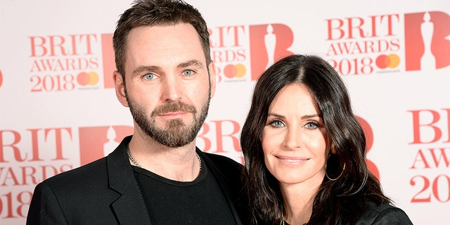 Johnny McDaid and Courteney Cox attend The BRIT Awards 2018 held at The O2 Arena on February 21, 2018 in London, England.